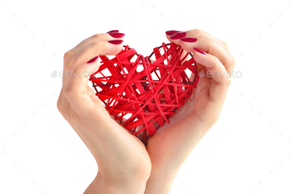 Wicker red heart in woman's hands on white background. Closeup h - Stock Photo - Images
