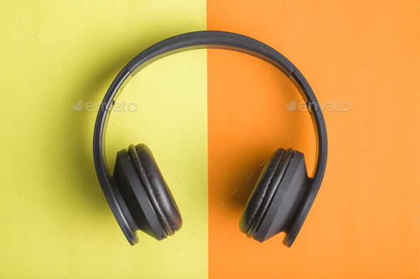 Headphones on double colorful background. - Stock Photo - Images