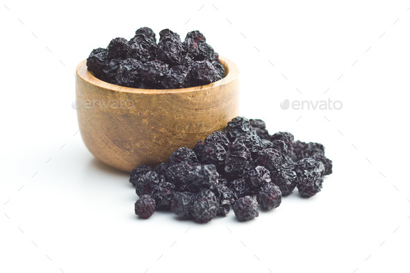 Dried chokeberries. Black aronia berries. - Stock Photo - Images