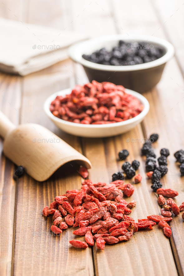 Dried chokeberries and goji berries. - Stock Photo - Images