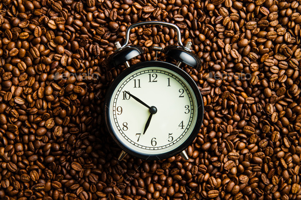 vintage alarm clock and coffee beans - Stock Photo - Images