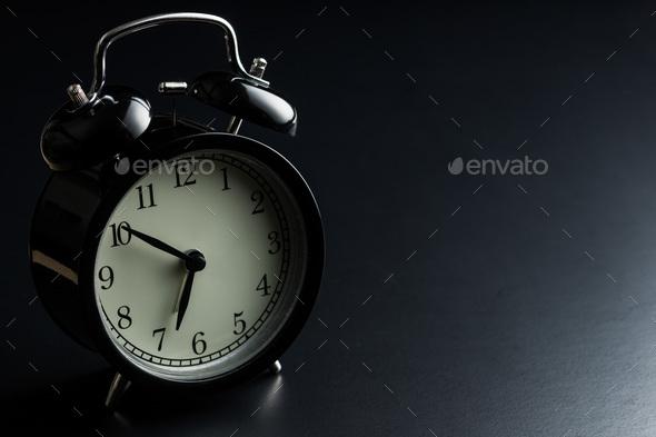 Black alarm clock. - Stock Photo - Images