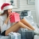Pretty Woman in Santa Hat Astonished with the Surprise Inside of the Red Box - VideoHive Item for Sale