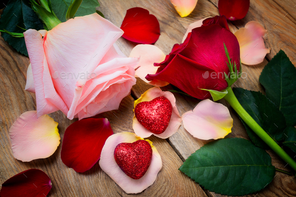 Valentines Day greeting with roses and two hearts on the  wooden - Stock Photo - Images