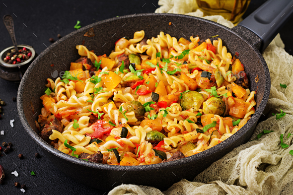 Fusilli vegetable paste with pumpkin, Brussels sprouts, paprika - Stock Photo - Images