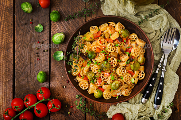 Vegetarian Vegetable pasta Rocchetti with brussels sprouts, tomato, eggplant - Stock Photo - Images