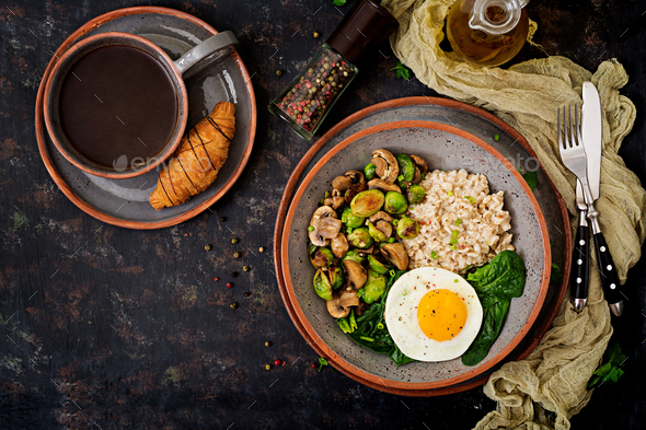 Oat porridge, egg and salad of baked vegetables - mushrooms and Brussels sprouts.  - Stock Photo - Images