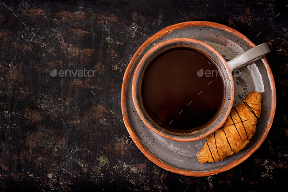 Cup of fragrant coffee and a croissant. Morning breakfast. Flat lay. Top view - Stock Photo - Images