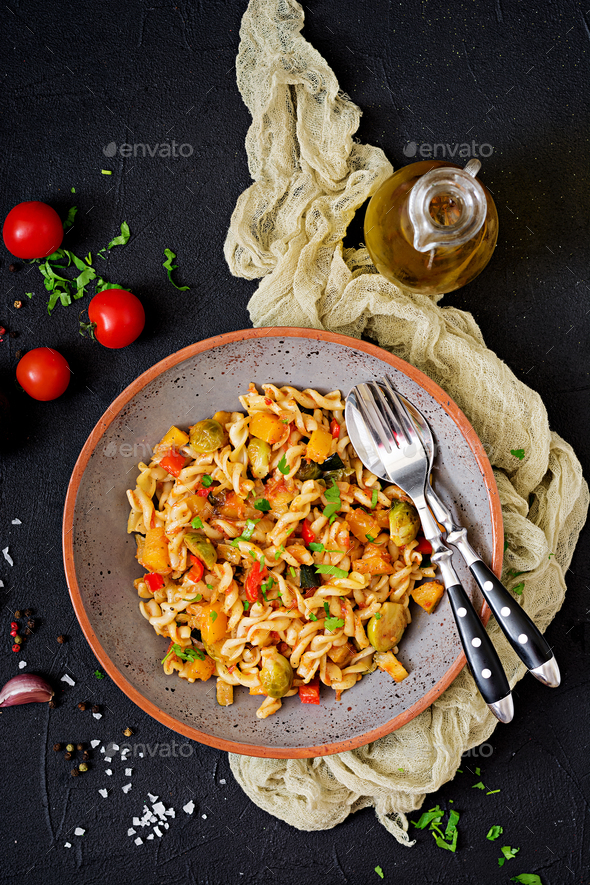 Vegan Fusilli vegetable paste with pumpkin, Brussels sprouts, paprika and carrot - Stock Photo - Images