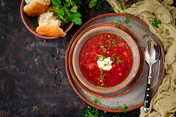 Traditional Ukrainian Russian borscht with beef on the bowl. Top view - Stock Photo - Images
