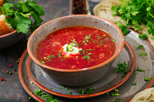 Traditional Ukrainian Russian borscht with beef on the bowl - Stock Photo - Images