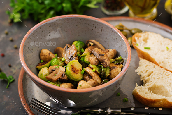 Vegan dish. Baked mushrooms with Brussels sprouts and herbs. Proper nutrition. Healthy lifestyle - Stock Photo - Images