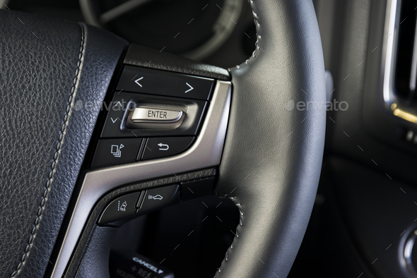 Media buttons on the steering wheel, car interior details - Stock Photo - Images