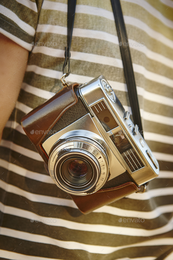 Traveler with vintage camera in the countryside. Travel background. Lifestyle - Stock Photo - Images