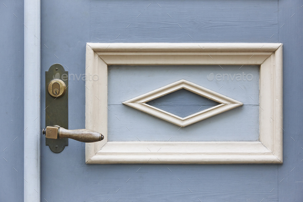 Classic doorknob on a vintage blue wooden door. Decoration. Horizontal - Stock Photo - Images