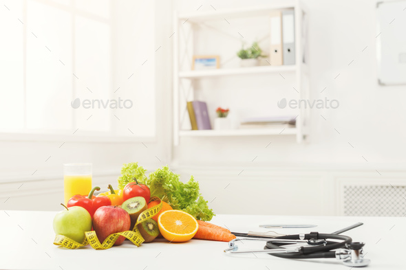 Nutritionist desk with fruit and stethoscope - Stock Photo - Images