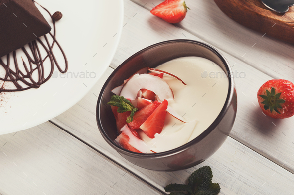 Coconut panna cotta with fresh strawberries - Stock Photo - Images