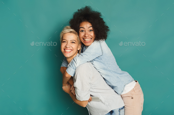 Happy friends having fun at blue background - Stock Photo - Images