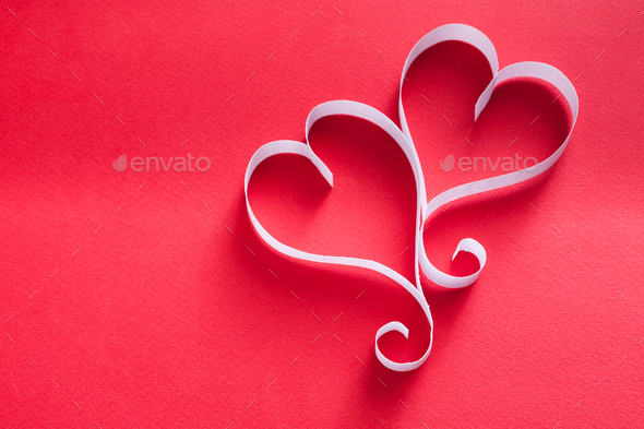 Handmade paper heart shapes decoration on red background - Stock Photo - Images