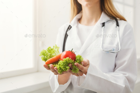 Unrecognizable nutritionist woman with vegetables - Stock Photo - Images
