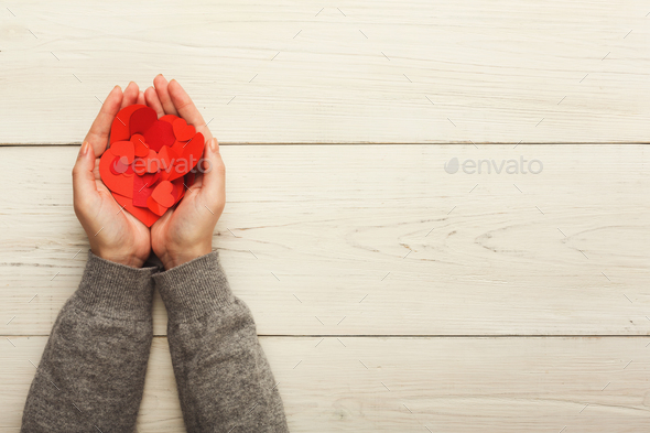 Valentine day background, clothespins in female hands - Stock Photo - Images