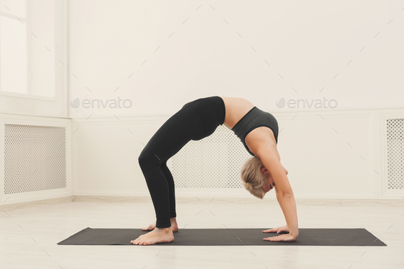 Woman training yoga in table top pose. - Stock Photo - Images
