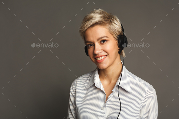 Woman listen to music in earphones, studio shot - Stock Photo - Images