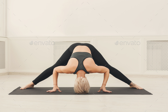Fitness woman at stretching training indoors - Stock Photo - Images