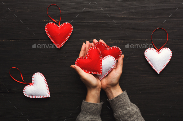 Valentine day background, pillow hearts in female hands - Stock Photo - Images