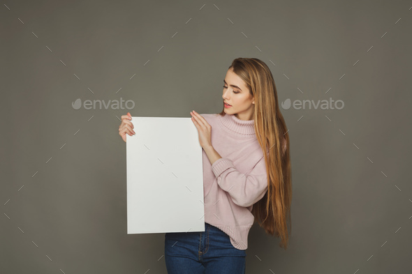 Young woman with blank white paper - Stock Photo - Images