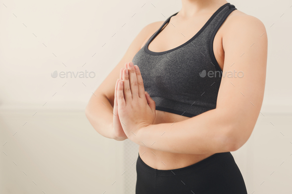 Unrecognizable woman practicing yoga in padmasana - Stock Photo - Images