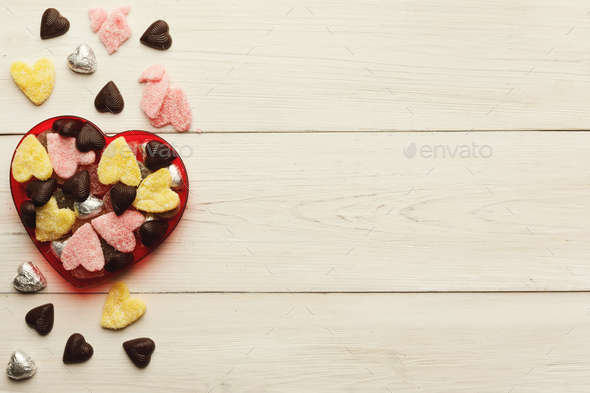 Lovers day background with various sweets in craft cornets - Stock Photo - Images