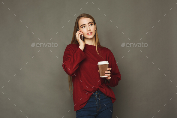 Woman speaking on phone and having coffee - Stock Photo - Images