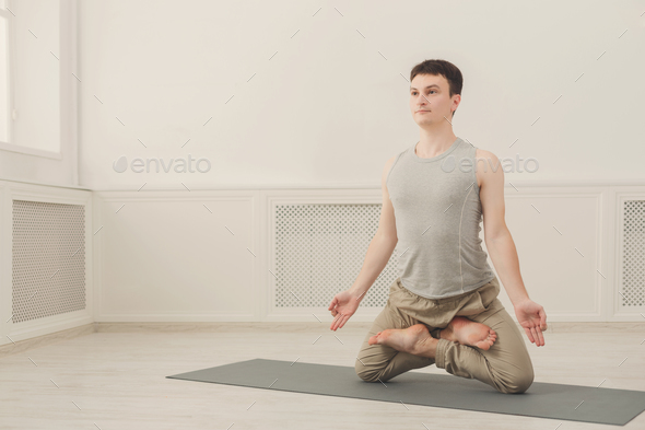 Sporty man practicing yoga. Lotus pose. - Stock Photo - Images