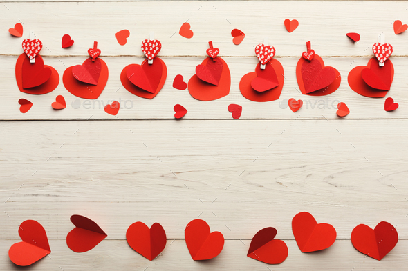 Valentine day background, paper hearts border on wood, copy space - Stock Photo - Images