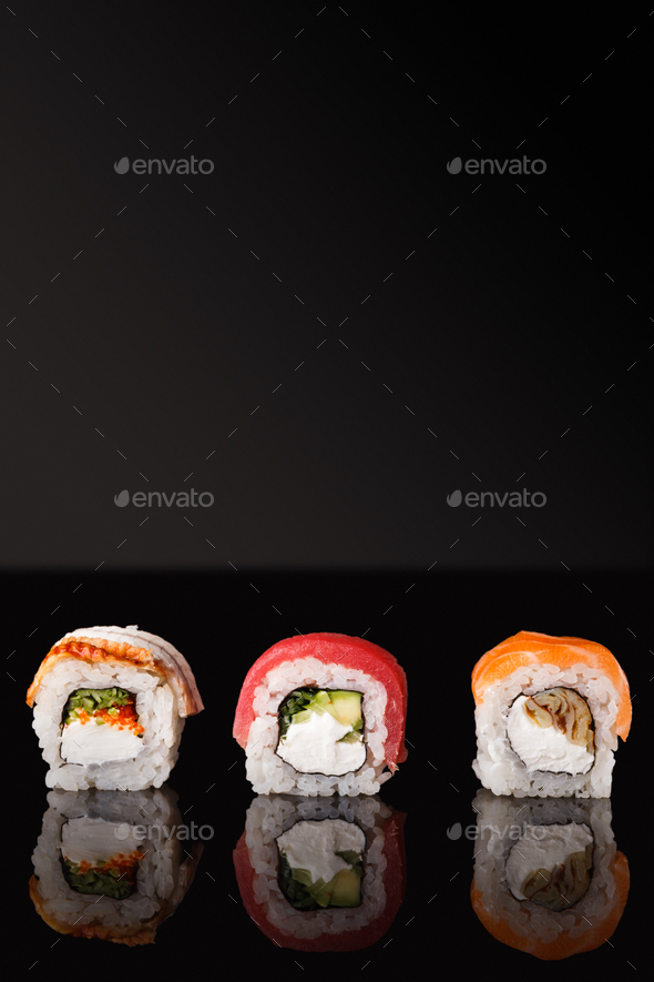 Japanese rolls on black mirroring background - Stock Photo - Images