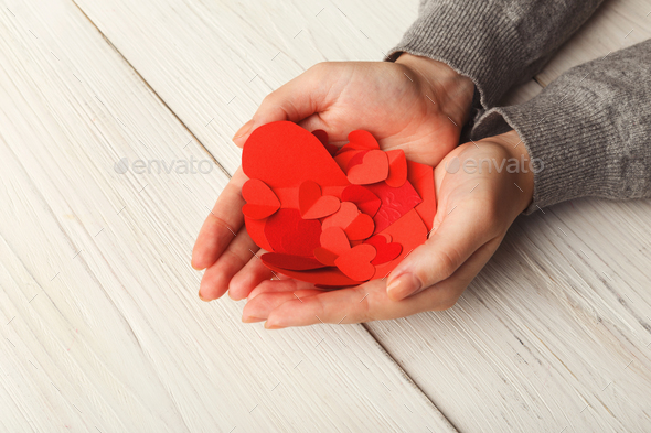 Valentine day background, hearts in female hands - Stock Photo - Images