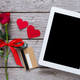 Online shopping holiday background, tablet screen, credit card, rose flower and paper hearts on - PhotoDune Item for Sale