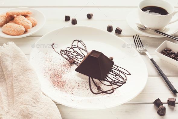 Chocolate truffle cake in pyramid shape - Stock Photo - Images
