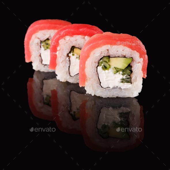 Japanese rolls on black mirroring background - Stock Photo - Images
