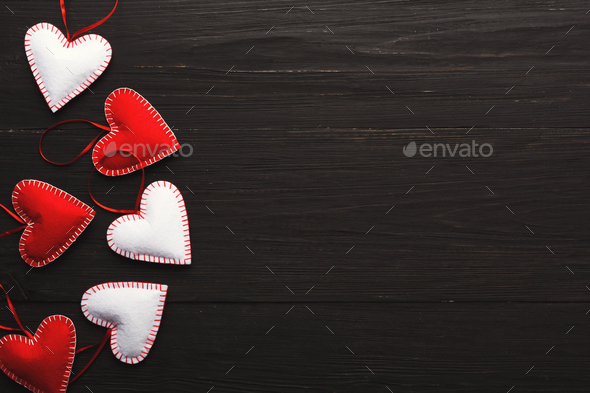 Valentine day background, handmade pillow hearts on wood, copy space - Stock Photo - Images