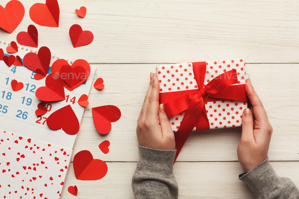 Valentine day background, gift box and hearts on white wood - Stock Photo - Images