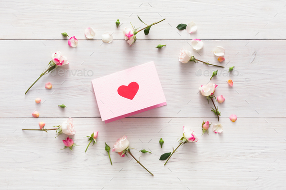Valentine background with handmade paper with heart in pink rose flowers circle on white rustic wood - Stock Photo - Images