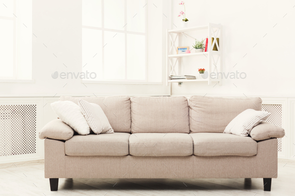 Beige couch on white window background - Stock Photo - Images