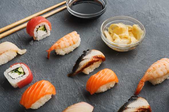 Sushi and rolls on gray background - Stock Photo - Images