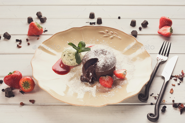 Chocolate fondant with vanilla ice cream and strawberry - Stock Photo - Images
