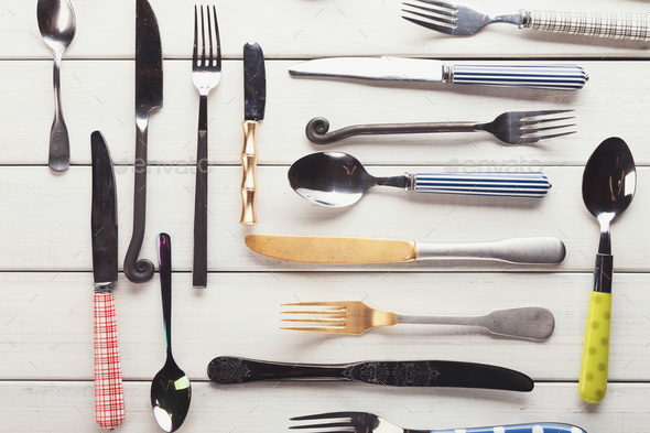 Collection of modern and antique cutlery, top view - Stock Photo - Images