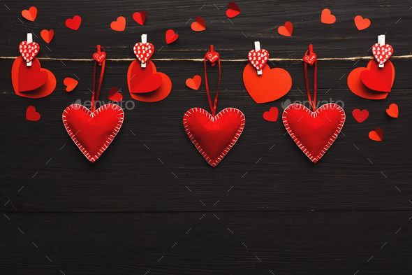 Valentine day background, pillow hearts border on wood, copy space - Stock Photo - Images