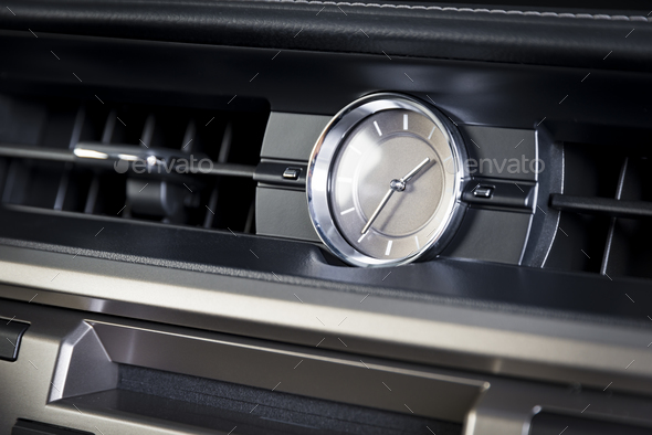 Watches in modern luxury car interior - Stock Photo - Images