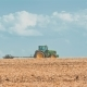 Tractor in Field After Harvest - VideoHive Item for Sale